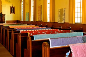 quilts on pews